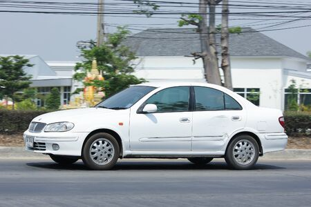 nissan: CHIANGMAI, THAILAND -MARCH 21 2016:   Private car, Nissan Sunny. Photo at road no 121 about 8 km from downtown Chiangmai, thailand. Editorial