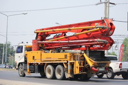 concrete pump: CHIANGMAI, THAILAND -APRIL 25 2016: CONCRETE PUMP Line Truck of INSEE Concrete company. Photo at road no 121 about 8 km from downtown Chiangmai, thailand.
