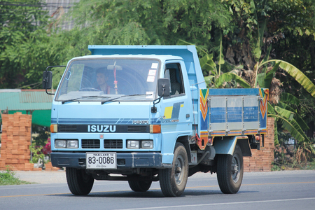 4 wheel: CHIANGMAI, THAILAND -MAY 6 2016:  Private Isuzu 4 Wheel Dump Truck.  Photo at road no 121 about 8 km from downtown Chiangmai, thailand.