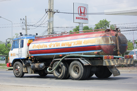 wetting: CHIANGMAI, THAILAND -MAY 26 2016: Payawan water Truck. Photo at Road No.121 about 8 Km from Chiangmai city.