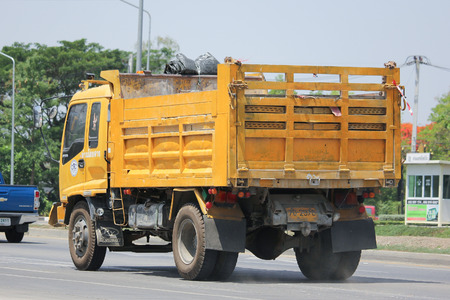 highway 6: CHIANGMAI, THAILAND -MAY 27 2016: Yellow Isuzu  Dump Truck of CRC Company. Photo at road no 121 about 8 km from downtown Chiangmai, thailand.