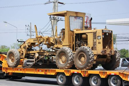 grader: CHIANGMAI, THAILAND -MAY 28 2016: Catterpillaer Road grader on Trailer truck. Photo at road no.1001 about 8 km from downtown Chiangmai, thailand.