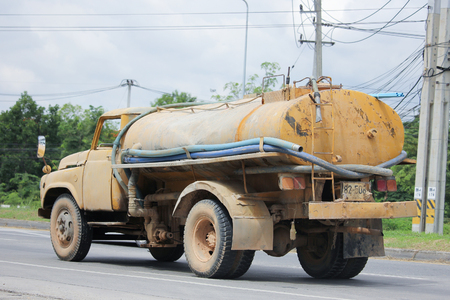 wetting: CHIANGMAI, THAILAND -JUNE 27 2016: Private old  water Tank Truck. Photo at Road No.121 about 8 Km from Chiangmai city.