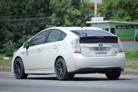 CHIANGMAI, THAILAND -JUNE 27 2016:  Private car, Toyota Prius. Photo at road no.121 about 8 km from downtown Chiangmai, thailand.