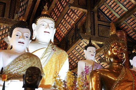 city location: CHIANGMAI, THAILAND -JULY 11 2016:  White Buddha statue in Inthakhin Sadue Muang Temple, Center on city Location Near Three Kings Monument.
