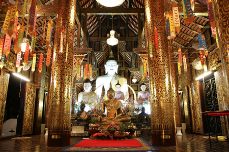 city location: CHIANGMAI, THAILAND -JULY 18 2016:  White Buddha statue in Inthakhin Sadue Muang Temple, Center on city Location Near Three Kings Monument.