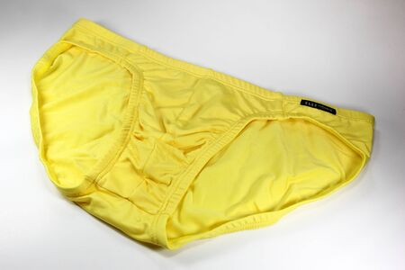 spandex: CHIANGMAI, THAILAND -JULY 23 2016: Product shot of Elle Homme, Yellow bikini Underwear from Tactel Fabric mix Spandex. Elle Homme in thailand made and sale by I.C.C. International Public Company.