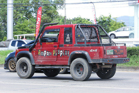 the jeep: CHIANGMAI, THAILAND -JULY 26 2016: Private car, Suzuki Caribian.  On road no.1001, 8 km from Chiangmai Business Area.