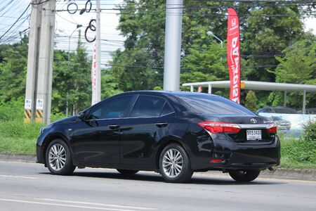 corolla: CHIANGMAI, THAILAND -JULY 26 2016:  Private car, Toyota Corolla Altis.  On road no.1001, 8 km from Chiangmai Business Area.