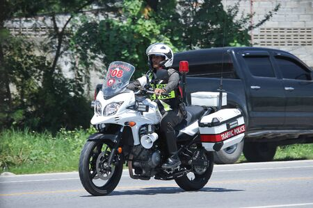 motorcycle officer: CHIANGMAI, THAILAND -JULY 27 2016:  Motorbike and Police Chiangmai Traffic Police.  On road no.1001, 8 km from Chiangmai Business Area.