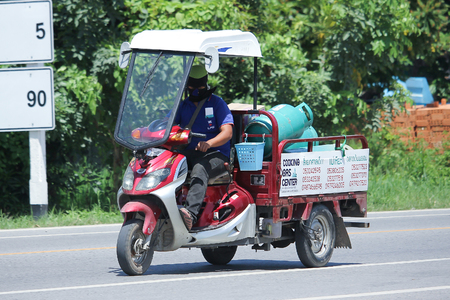ngv: CHIANGMAI, THAILAND -JULY 27 2016:  Motorcycle for delivery gas lpg to home of Champ Company.   On road no.1001, 8 km from Chiangmai Business Area.