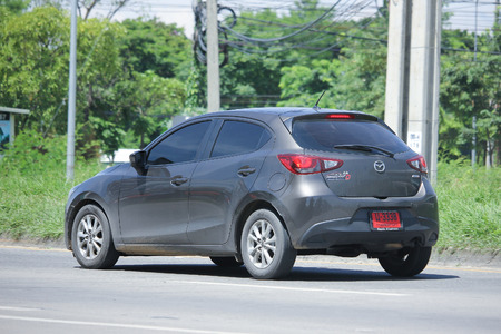 mazda: CHIANGMAI, THAILAND -JULY 27 2016:  Private Eco car, Mazda 2.   On road no.1001, 8 km from Chiangmai Business Area.