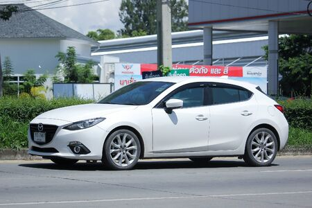 mazda: CHIANGMAI, THAILAND -JULY 27 2016:  Private Eco car, Mazda 3.   On road no.1001, 8 km from Chiangmai Business Area. Editorial