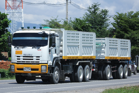 truckload: CHIANGMAI, THAILAND -JULY 27 2016:   Isuzu Trailer dump truck of D stone company. On road no.1001, 8 km from Chiangmai Business Area.