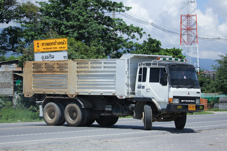 truckload: CHIANGMAI, THAILAND -JULY 27 2016:  Old Private Mitsubishi Fuso Dump Truck.  On road no.1001, 8 km from Chiangmai Business Area. Editorial