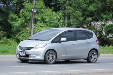 automobile door: CHIANGMAI, THAILAND -AUGUST 9 2016:  Private Honda Jazz Car, Five door hatchback automobile. On road no.1001, 8 km from Chiangmai Business Area.