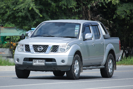 nissan: CHIANGMAI, THAILAND -AUGUST 9 2016:  Private Pickup car, Nissan Navara. On road no.1001, 8 km from Chiangmai Business Area.