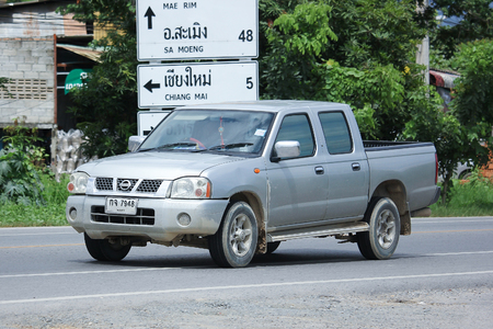 frontier: CHIANGMAI, THAILAND -AUGUST 9 2016:  Private Pickup car, Nissan Frontier. On road no.1001, 8 km from Chiangmai Business Area.
