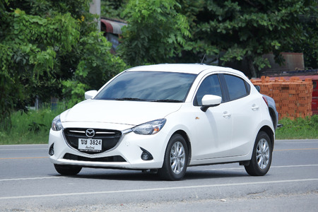 km: CHIANGMAI, THAILAND -AUGUST 9 2016:  Private Eco car, Mazda 2. On road no.1001, 8 km from Chiangmai Business Area.