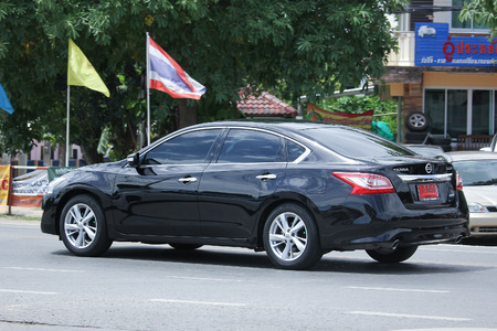 nissan: CHIANGMAI, THAILAND -AUGUST 9 2016:   Private car, Nissan Teana.  On road no.1001, 8 km from Chiangmai Business Area.