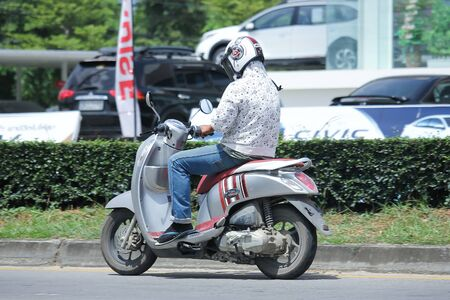 km: CHIANGMAI, THAILAND -AUGUST 10 2016:  Private Honda Scoopy i Motorcycle.  On road no.1001, 8 km from Chiangmai Business Area.