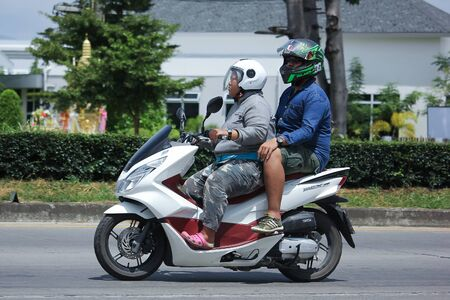 motobike: CHIANGMAI, THAILAND -AUGUST 10 2016:  Private Honda Motorcycle, PCX 150. On road no.1001, 8 km from Chiangmai Business Area.