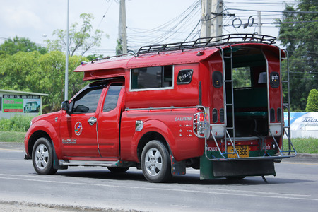 CHIANGMAI, THAILAND -AUGUST 10 2016: Red taxi chiangmai, Nissan Navara. Service in city and around.  On road no.1001, 8 km from Chiangmai Business Area.