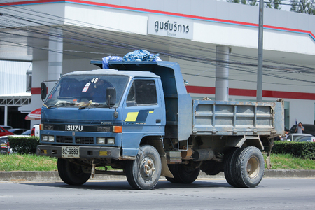 highway 6: CHIANGMAI, THAILAND -AUGUST 10 2016:  Isuzu Dump Truck of Sor Service Transport.  On road no.1001, 8 km from Chiangmai Business Area. Editorial