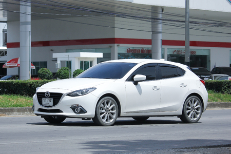 mazda: CHIANGMAI, THAILAND -AUGUST 10 2016: Private car, Mazda 3.   On road no.1001, 8 km from Chiangmai Business Area. Editorial