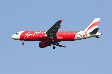 CHIANGMAI , THAILAND - FEBRUARY 26 2014: HS-ABB Airbus A320-200 of Thaiairasia. Landing to Chiangmai airport from Bangkok Don Muang, thailand.