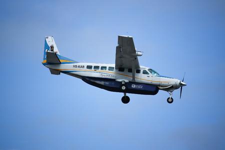 grand son: CHIANGMAI, THAILAND - SEPTEMBER  4  2016:  HS-KAB Cessna Grand Caravan 208B of Kanair. landing to Chiangmai airport flight from Mae hong son.