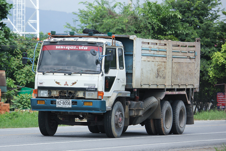 truckload: CHIANGMAI, THAILAND -AUGUST 18 2016:  Private Old Mitsubishi Dump Truck.  On road no.1001, 8 km from Chiangmai city.