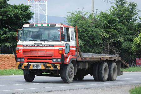 truckload: CHIANGMAI, THAILAND -AUGUST 18 2016:  Private Old Nissan Diesel Truck. On road no.1001, 8 km from Chiangmai city.