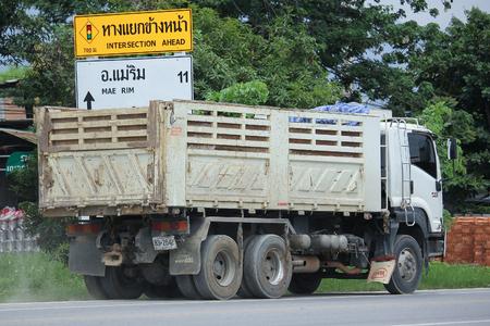 truckload: CHIANGMAI, THAILAND -AUGUST 18 2016:   Isuzu Trailer dump truck of D stone company.  On road no.1001, 8 km from Chiangmai city. Editorial