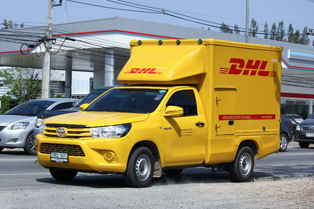 CHIANGMAI, THAILAND -FEBRUARY 29 2016: DHL Express and Logistics Container Pickup truck. Modify from Toyota Hilux Revo. Photo at road no 121 about 8 km from downtown Chiangmai, thailand. Editorial
