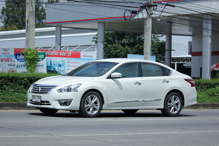 nissan: CHIANGMAI, THAILAND - OCTOBER 2  2016: Private car, Nissan Teana. On road no.1001, North of city about 8 km from Chiangmai Center.