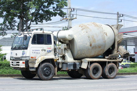 concrete truck: CHIANGMAI, THAILAND - OCTOBER 6  2016: Concrete truck, Nissan UD of Chiangmai Concrete product company. Photo at road no.121 about 8 km from downtown Chiangmai, thailand. Editorial