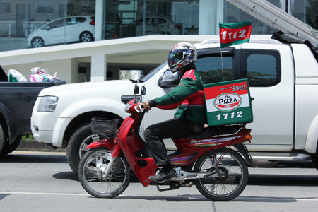 CHIANGMAI, THAILAND - OCTOBER 8  2016:  Delivery service man ride a Motercycle of The Pizza Company. In Busy Traffic On road no.1001, 8 km from Chiangmai Business Area. Editorial