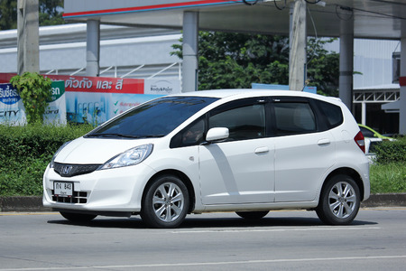 automobile door: CHIANGMAI, THAILAND - OCTOBER 8  2016:  Private Honda Jazz Car, Five door hatchback automobile. On road no.1001, 8 km from Chiangmai Business Area.