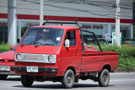 CHIANGMAI, THAILAND - OCTOBER 9  2016: Private Old Mini Pick up Truck, Suzuki Carry.  On road no.1001, 8 km from Chiangmai city. Editorial