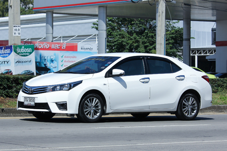 corolla: CHIANG MAI, THAILAND - OCTOBER  27  2016:  Private car, Toyota Corolla Altis. On road no.1001, 8 km from Chiangmai city. Editorial