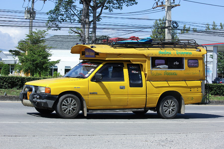 CHIANG MAI, THAILAND - OCTOBER  31  2016:  Yellow mini truck taxi chiangmai, Service between city and Maejam Subdistrict. Photo at road no 121 about 8 km from downtown Chiangmai, thailand.