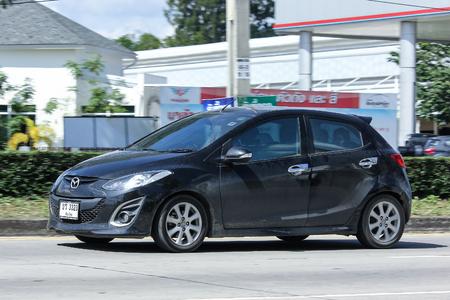 2 november: CHIANG MAI, THAILAND - NOVEMBER  13  2016: Private car, Mazda 2. On road no.1001, 8 km from Chiangmai Business Area.