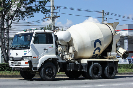 concrete truck: CHIANG MAI, THAILAND - NOVEMBER  15  2016: Concrete truck of Chiangmai Concrete product company. Photo at road no.121 about 8 km from downtown Chiangmai, thailand. Editorial