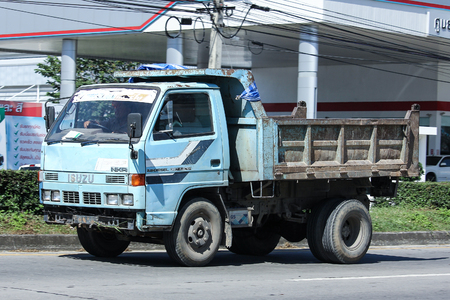 truckload: CHIANG MAI, THAILAND - NOVEMBER  18  2016: Private Old isuzu Dump Truck. On road no.1001, 8 km from Chiangmai city.