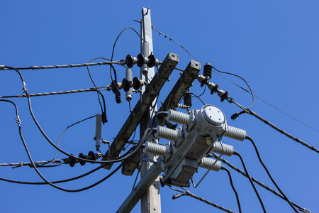 eletrical: Closeup Eletricity line and electricity post wtih blue sky background Stock Photo
