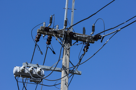 telephone poles: Closeup Eletricity line and electricity post wtih blue sky background Stock Photo