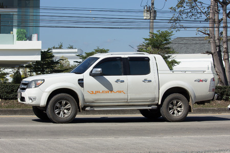 truck driver: CHIANG MAI, THAILAND -JANUARY 16 2017: Private Pickup car, Ford Ranger. On road no.1001, 8 km from Chiangmai city.