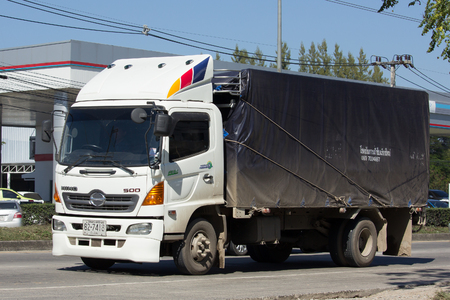 truck driver: CHIANG MAI, THAILAND -JANUARY 16 2017:  Private Hino Cargo Truck. On road no.1001, 8 km from Chiangmai Business Area.