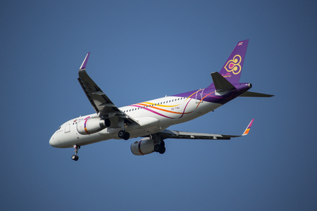 CHIANG MAI, THAILAND -APRIL 29 2017:  HS-TXU  A320-200 of Thai smile airway. Landing to Chiangmai airport from Bangkok.